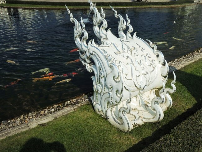 pieces in garden of wat rong khun