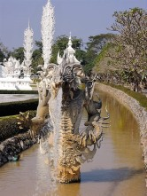 dragon in the river in wat rong khun
