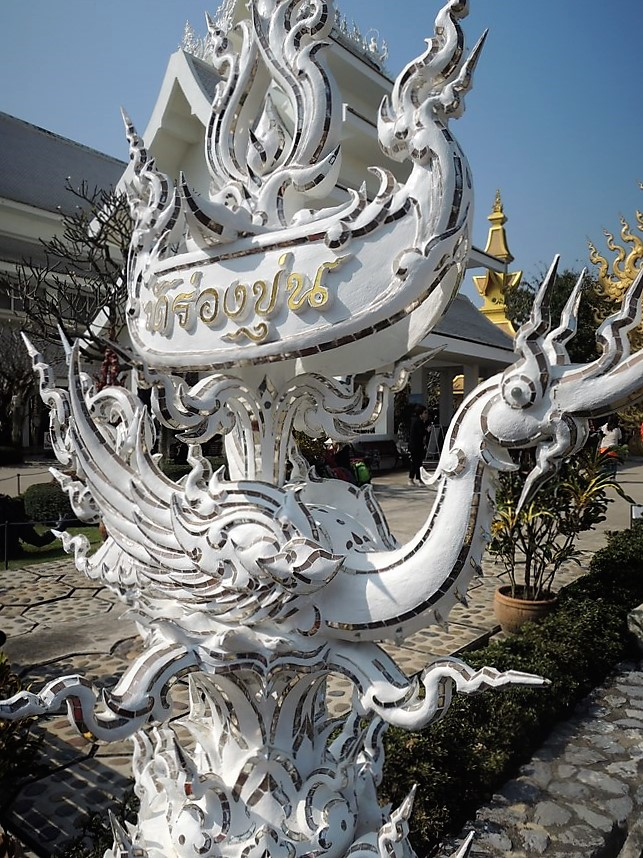 statue in white temple thailand