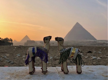 camel toy pyramides sunset